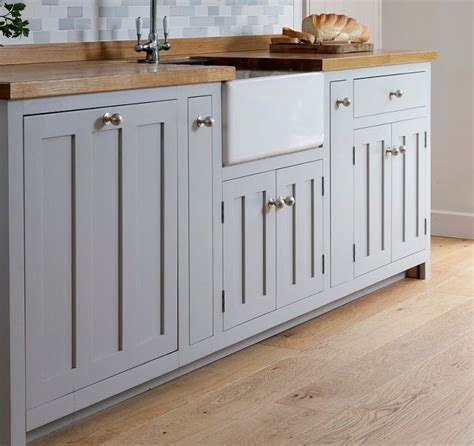 grey kitchen cabinets  butcher block countertops