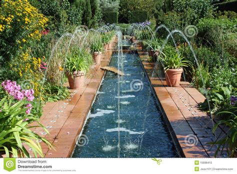 House Plans Country Style Fountains In A Spanish Style Garden Royalty Free Stock