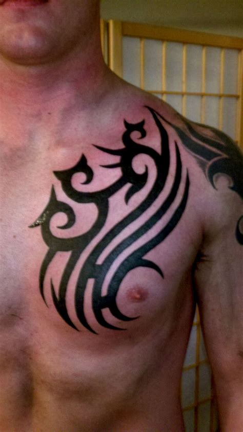 tribal tattoo on chest and shoulder 25 beautiful tribal chest tattoos only tribal