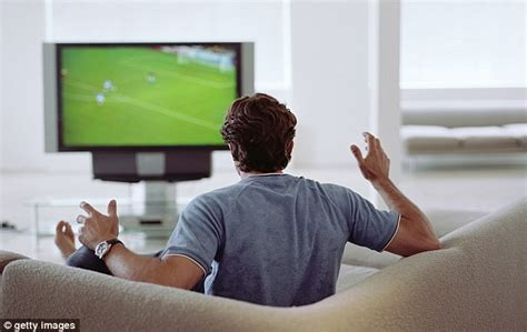 watch tv couch divided by television a quarter of couples spend the