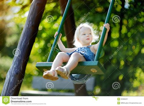 swing swing swing on a summer day adorable girl having fun on a swing stock image image