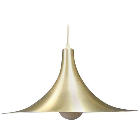 gubi semi pendant in brass by claus bonderup and thorsten