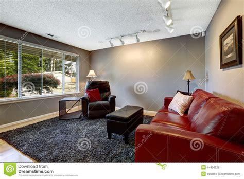 what colour carpet goes with red sofa room in grey color with bright red sofa stock image