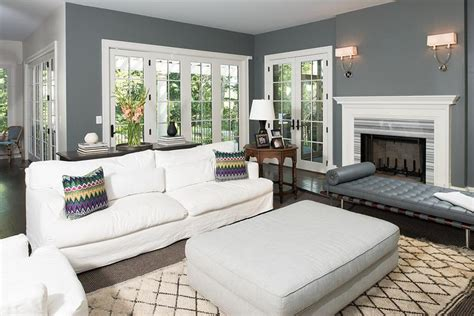 Nice Nice Living Room Rugs #2: White-and-charcoal-gray-living-room-features-a-gray-leather-Barcelona-Bench-placed-in-front-of-a-white-fireplace-mantle-accented-with-a-gray-striped-marble-gray-living-room-rugs.jpg