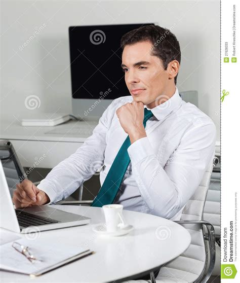 Desk It Manager by Manager With Laptop At Office Desk Stock Photos Image