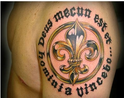 inscription tattoo designs gold fleur de lis and black inscription on shoulder