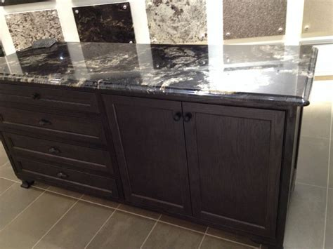 BLack titanium granite with dark brown cabinets   Home