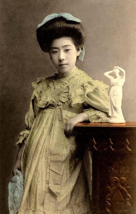 portrait of a geisha or geiko in western clothing ca