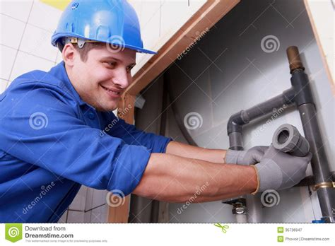 Mr H2o Plumbing by Plumber Fitting Water Pipes Royalty Free Stock Photography