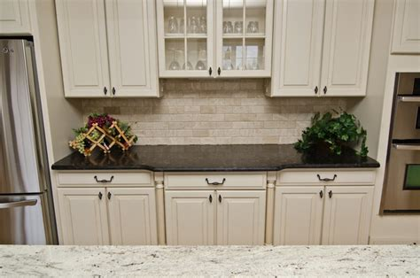 white kitchen cabinets with antique brown granite leathered antique brown granite and river valley granite