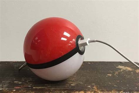 Handcrafted Pokeballs - the handmade pokeball power bank provides mobile energy
