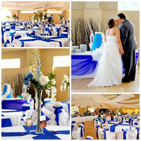 wedding flowers decor royal blue cream gym reception