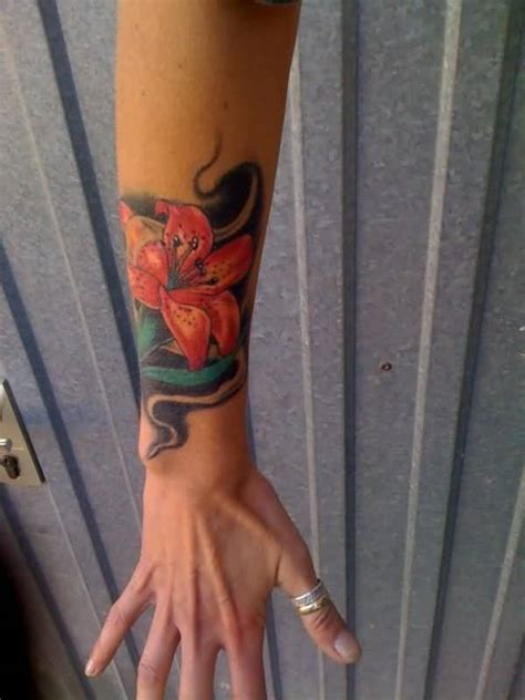 lily wrist tattoo ideas and designs page 38