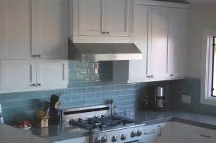 blue kitchen with tile backsplash