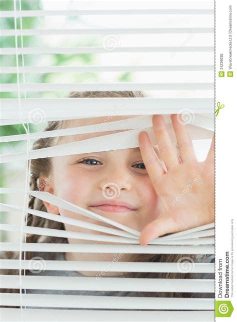 Abc Blinds Happy Child Peeking Through Blinds Stock Photo Image