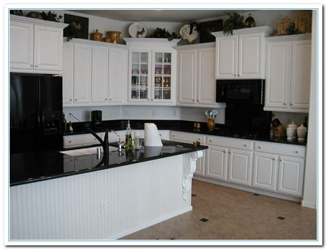 Kitchen With Black Countertops And White Cabinets by White Cabinets With Granite Countertops Home And Cabinet