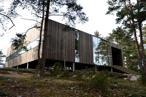 how to buy a house in norway beautiful wooden home in norway is built around forest trees inhabitat green