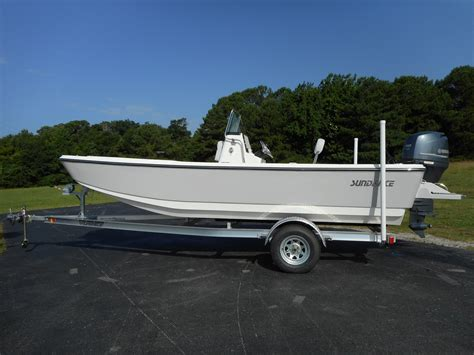 flat bottom boat with console fishing skiffs center consoles flats boats