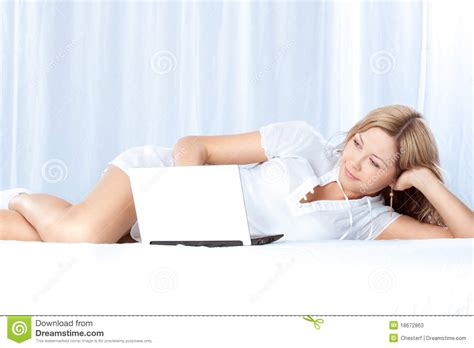 lying in my bed woman lying on bed with laptop stock photos image 18672863