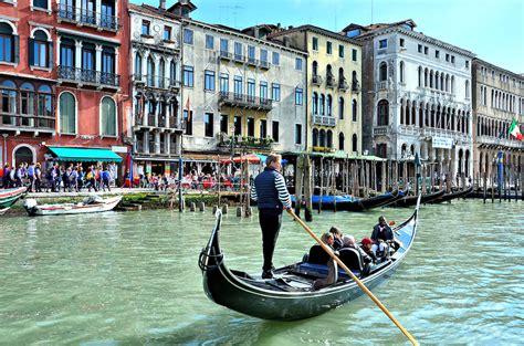 gondola boat venice gondola rowing along grand canal in venice italy