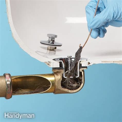 bathtub drain clogged with hair unclog a bathtub drain without chemicals the family handyman