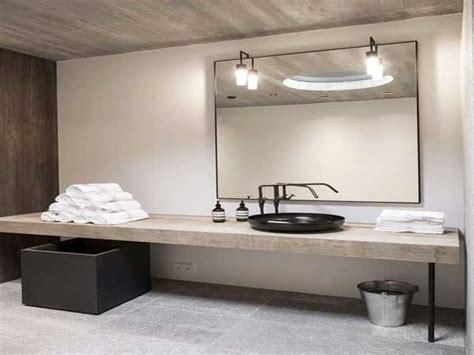 Formidable Deco Zen Salle De Bain #3: dalles-beton-et-plan-vasque-bois-dans-salle-de-bain-zen.jpg