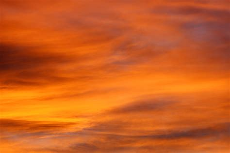 sunset orange brilliant orange sunset clouds picture free photograph