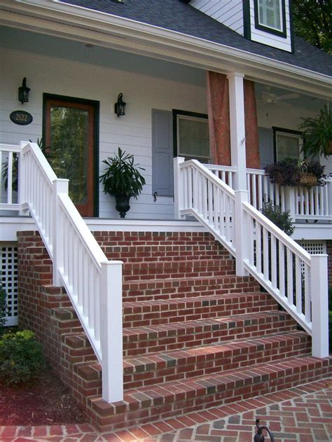 red brick steps provide contrast   bright white home