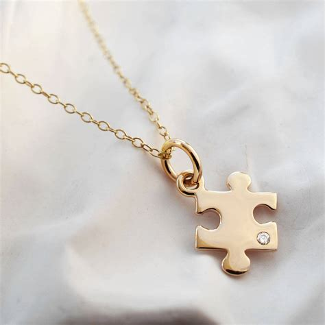 9 Pieces Of Jewelry by Nine Carat Gold Jigsaw Puzzle Necklace With Sapphire By