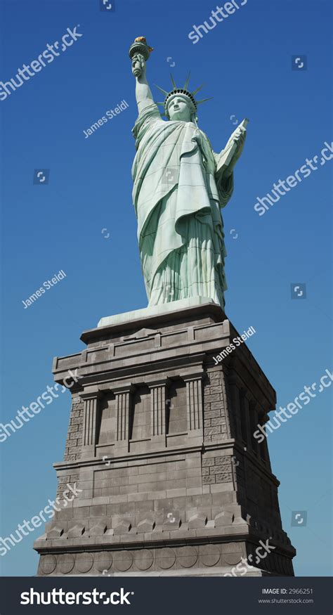 liberty out of a clear blue sky books worm s eye view of the statue of liberty on a clear day