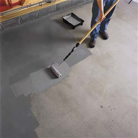 Garage Floor Paint Roller Roll The Epoxy Paint How To Epoxy Coat A Garage Floor