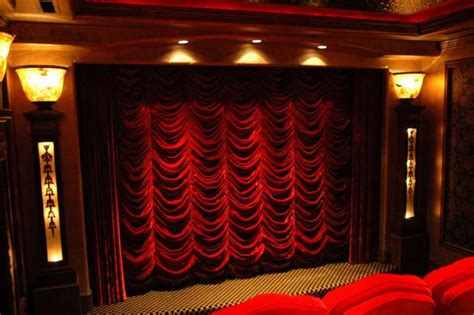 theater room drapes fantastic red velvet curtains over the movie screen in a
