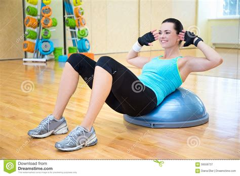 woman  exercises  abdominal muscles  bosu ball stock photo image