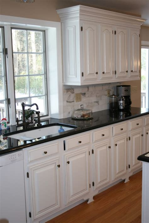 Kitchen Counter Cabinet by White Kitchens With Black Countertops White Cabinets