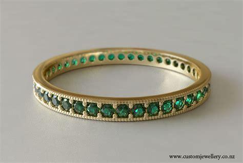 emerald wedding band bead set in yellow gold new zealand