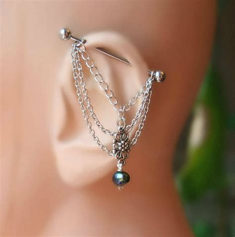 industrial barbell with chains industrial piercing jewelry