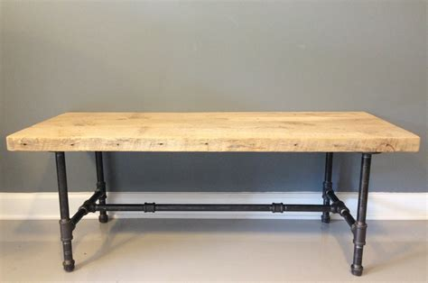reclaimed wood coffee table with industrial pipe legs by