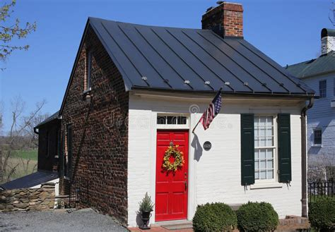 brick house with red door old brick house with a red door stock image image of