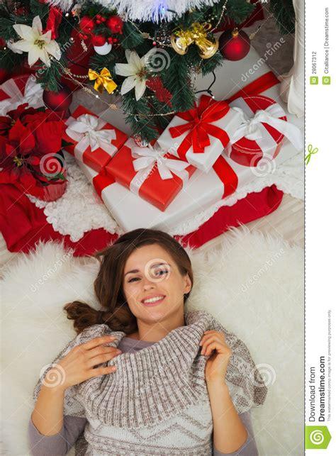 happiest christmastree happy laying near tree royalty free stock image cartoondealer 27728206