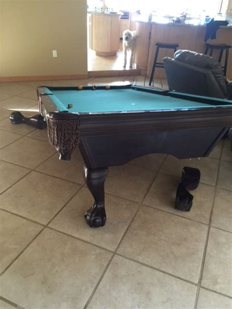 they hired a cheap pool table mover move a pool table