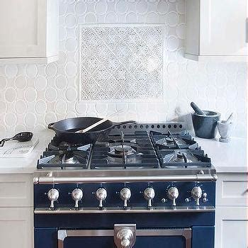french blue and white ceramic tile backsplash blue kitchen cabinets with arabesque backsplash tiles