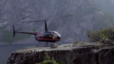 Bradley Friesen by Helicopter Landing Edge Of A Cliff Day In The Life Of
