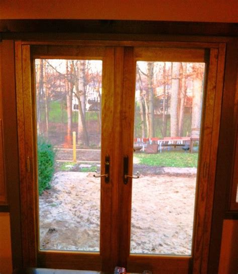 outswing patio doors with retractable screens andersen outswing door with retractable screen