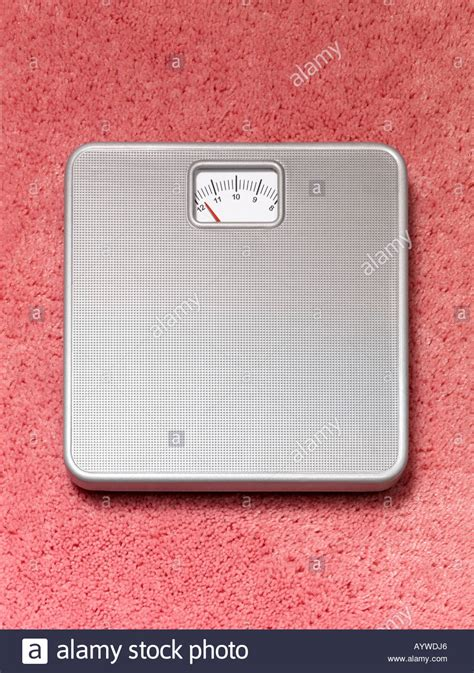 bathroom scales carpet a bathroom weighing scales on a pink fluffy carpet stock