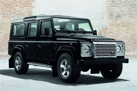 black land rover with black official land rover defender black pack and silver pack