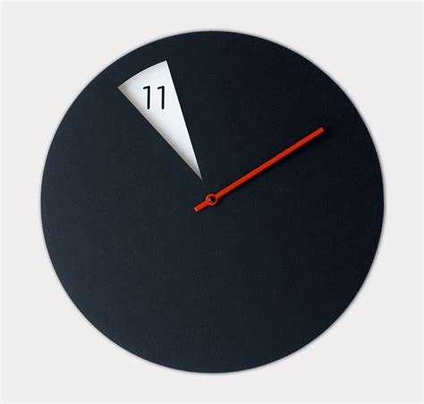 design milk clock pie shaped clock reveals the hours as they pass design milk