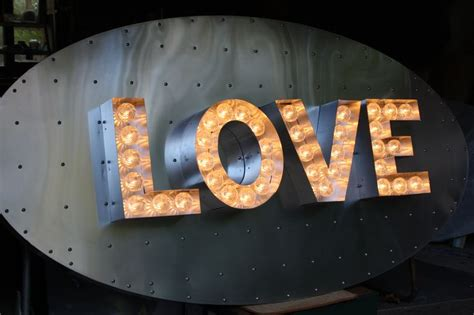 wall mounted lovelight light up letters mounted on studded aluminium oval