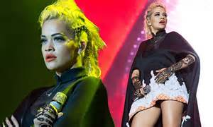 rita ora dazzles in stylish cape style dress at gnc