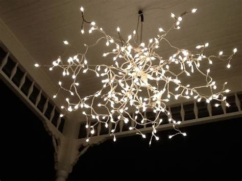 drapey christmas lights umbrella frame without the cloth spray painted white then draped with a line of