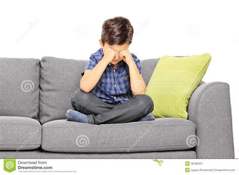 couch sitting sad boy sitting on a couch and crying stock image image